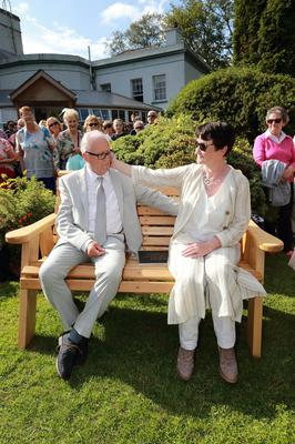 Ana Kriégel's parents Geraldine and Patrick pictured sitting on a bench with after they planted a White Cherry Blossom in her memory at the Leixlip Manor Hotel in beside St Catherine Park. Picture: Frank McGrath