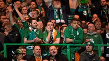 Dejected Ireland supporters wonder what could have been after their side's Euro 2016 qualifier defeat to Scotland at Celtic Park. Photo: David Maher / SPORTSFILE
