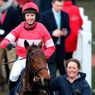 Noel Fehily celebrates on Eglantine Du Seuil after winning the National Hunt Breeders Supported By Tattersalls Mares' Novices' Hurdle