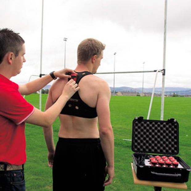 Sean O'Connor, co-founder of STATSports, fits a GPS Viper pod to a footballer.