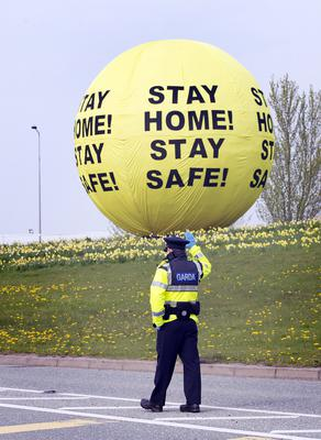A Garda checkpoint on the Johnstown Road, Naas with a new message on the Naas Ball in the background. Photo: Tony Gavin 10/4/2020