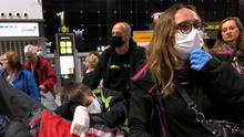 Ready for take off: People wait for their flight as they wear protective masks at the airport in Malaga, Spain. Photo: REUTERS/Kacper Pempel