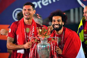 LIVERPOOL, ENGLAND - JULY 22: Dejan Lovren and Mohamed Salah of Liverpool celebrate with The Premier League trophy following the Premier League match between Liverpool FC and Chelsea FC at Anfield on July 22, 2020 in Liverpool, England. Football Stadiums around Europe remain empty due to the Coronavirus Pandemic as Government social distancing laws prohibit fans inside venues resulting in all fixtures being played behind closed doors. (Photo by Paul Ellis/Pool via Getty Images)