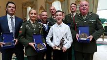 At ease: (left-right) Gunner David Stack, Cpl Caitriona Lacey, Navy Engineering Officer Ryan O'Driscoll, RSM John Murray, Charlie Watson (15), Cpl David McCormack and Sgt PJ McCabe receive Defence Force Values Awards at Áras an Uachtaráin. Photo: Maxwells Dublin