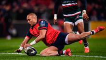Simon Zebo of Munster goes over to score his side's second try during the European Rugby Champions Cup