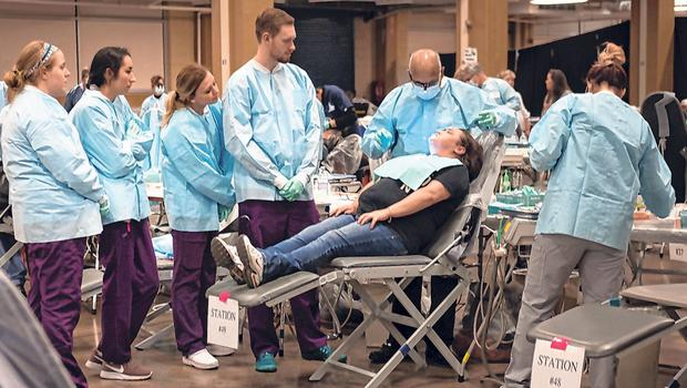 Sick stat: Patients receive dental assistance at a clinic in Knoxville, Tennessee. Millions have lost their healthcare coverage, and the uninsured rate has risen, in just two years, from 10.9pc to 13.7pc. Photo: Spencer Platt/Getty Images