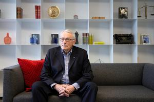 International Olympic Committee (IOC) member Dick Pound, poses in his offices in Montreal, Quebec, Canada last February