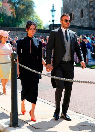 David Beckham and Victoria Beckham arrive at St George's Chapel at Windsor Castle for the wedding of Meghan Markle and Prince Harry. PRESS ASSOCIATION Photo. Picture date: Saturday May 19, 2018. See PA story ROYAL Wedding. Photo credit should read: Gareth Fuller/PA Wire