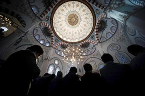 Muslims residing in Japan offer Friday prayers at Tokyo Camii, the largest mosque in Japan, in Tokyo, on Friday. The deadline for paying ransom for two Japanese hostages held by the Islamic State group was fast approaching early Friday with no signs of a breakthrough (AP Photo/Eugene Hoshiko)