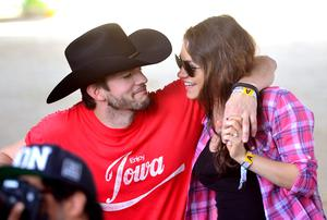 Actors Ashton Kutcher (L) and Mila Kunis attend day 1 of 2014 Stagecoach: California's Country Music Festival at the Empire Polo Club