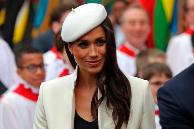 Prince Harry's fiancee, US actress Meghan Markle smiles after attending a Commonwealth Day Service at Westminster Abbey in central London