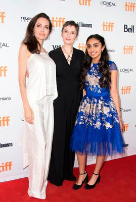 (L-R) Actress Angelina Jolie, director Nora Twomey and actress Saara Chaudry attend the world premiere of The Breadwinner during the 2017 Toronto International Film Festival September 10, 2017, in Toronto, Ontario. / AFP PHOTO / VALERIE MACONVALERIE MACON/AFP/Getty Images