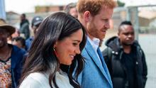 Britain's Prince Harry, Duke of Sussex(R) and Meghan, Duchess of Sussex(L) leave the Youth Employment Services Hub in Tembisa township, Johannesburg, on October 2, 2019 SPATARI/AFP via Getty Images)