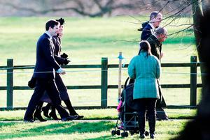 The Duke of Cambridge (second right), the Duke of Edinburgh (right) and the Duchess of Cambridge (back) arrive at St. Mary Magdalene Church in Sandringham, Norfolk, to attend a morning church service. Picture: Chris Radburn/PA Wire