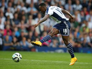 "West Bromwich Albion's Saido Berahino shoots to score his team's third goal during their English Premier League soccer match against Burnley at The Hawthorns in West Bromwich, central England, September 28, 2014. REUTERS/Andrew Yates   (BRITAIN - Tags: SPORT SOCCER) NO USE WITH UNAUTHORIZED AUDIO, VIDEO, DATA, FIXTURE LISTS, CLUB/LEAGUE LOGOS OR ""LIVE"" SERVICES. ONLINE IN-MATCH USE LIMITED TO 45 IMAGES, NO VIDEO EMULATION. NO USE IN BETTING, GAMES OR SINGLE CLUB/LEAGUE/PLAYER PUBLICATIONS. FOR EDITORIAL USE ONLY. NOT FOR SALE FOR MARKETING OR ADVERTISING CAMPAIGNS"