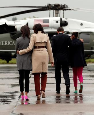 U.S. President Barack Obama (2nd R) with first lady Michelle Obama and daughters Malia (L) and Sasha (R) walk to Marine One upon their arrival on Air Force One in Belfast, Northern Ireland June 17, 2013