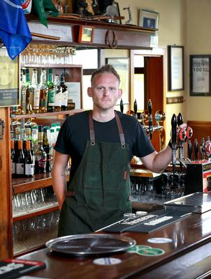 Big challenge: Manager Paolo Cafolla at the bar in Byrne's of Galloping Green in Stillorgan. PHOTO: Frank McGrath