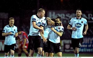 11 September 2015; Dundalk's Ronan Finn, centre celebrates with team-mates Chris Shields, left, and Darren Meenan after scoring his side's third goal. Irish Daily Mail FAI Senior Cup, Quarter-Final, Dundalk v Sligo Rovers, Oriel Park, Dundalk, Co. Louth. Picture credit: David Maher / SPORTSFILE