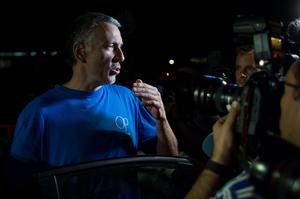 Brett King talks to the press as he leaves Soto Del Real prison with his wife in Madrid, Spain, Tuesday, Sept. 2, 2014