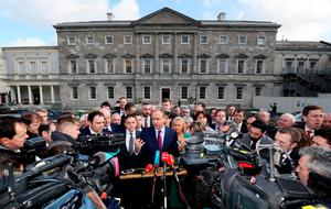 Fianna Fail leader Micheal Martin (centre) with party TD's, speaks to the media on the plinth at Leinster House, Dublin, for the first sitting of the 33rd Dail. Photo: Brian Lawless/PA Wire
