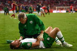 INJURY BLOW: Alan Judge attended to by Ireland team doctor Alan Byrne during the Euro 2020 qualifier against Denmark in Copenhagen last June. Photo by Stephen McCarthy/Sportsfile