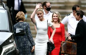 Tense scenes: Amber Heard leaves the High Court in London with her lawyer Jen Robinson. Photos: Simon Dawson/Reuters