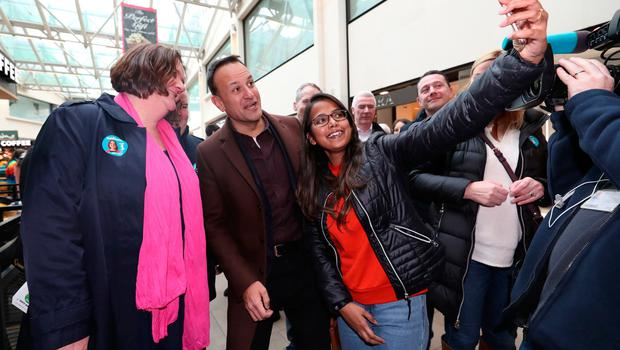 Snap happy: Leo Varadkar and Fine Gael candidate Gabrielle McFadden go canvassing in the Sheraton shopping centre in Athlone, Co Westmeath. Picture: PA
