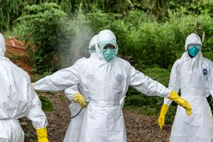 Members of the Ebola body management go to remove dead bodies from a make shift morgue at Kenema General Hospital in Sierra Leone. Pic:Mark Condren