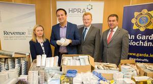 Minister Varadkar and officials with the seized 'medicines'
