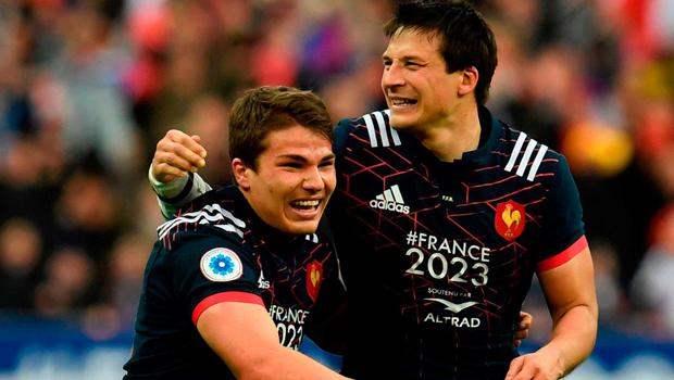 France's scrum-half Antoine Dupont (L) and France's fly-half Francois Trinh-Duc celebrate their victory. Photo: Christophe Simon/AFP/Getty Images