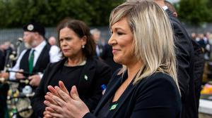 'Do as we say, not as we do': Deputy First Minister Michelle O'Neill and Mary Lou McDonald during the funeral of Bobby Storey at Milltown Cemetery in west Belfast. Photo: PA