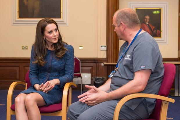 Britain's Catherine, Duchess of Cambridge (L), speaks to Clinical Director and Consultant in Emergency Medicine Dr Malcolm Tunnicliff as she visits Kings College Hospital to meet staff and patients affected by the terrorist attacks at London Bridge and Borough Market on June 3, in south London on June 12, 2017. (Photo credit@DOMINIC LIPINSKI/AFP/Getty Images)