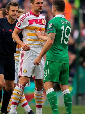 Scotland's Russell Martin (left) and Ireland's Robbie Brady during the UEFA European Championship Qualifying match at the Aviva Stadium, Dublin. Niall Carson/PA Wire