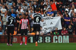 Newcastle United fans hold a 'Pardew Is A Muppet' banner during the Barclays Premier League match between Southampton and Newcastle United at St Mary's on Saturday.  Photo credit: Mike Hewitt/Getty Images