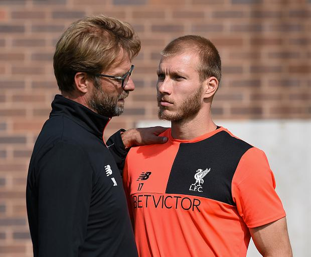 Jurgen Klopp manager of Liverpool talks with Ragnar Klavan during a training session
