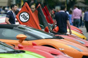 Lamborghini sport cars owners check their cars on May 7, 2013 in front of Milan's Sforza castle in Milan on the eve of the first leg of a 1,200km Grand Tour through Italy to mark the 50th anniversary of the carmaker. (OLIVIER MORIN/AFP/Getty Images)