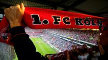 An FC Cologne fan displays her fan scarf before her team's second German soccer league match against FC Union Berlin.  Pic: Reuters/Wolfgang Rattay/File Photo