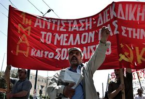 Protesters march during a May Day rally at central Syntagma square in Athens