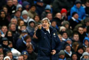 Manchester City's manager Manuel Pellegrini reacts during their English Premier League soccer match against Chelsea at the Etihad Stadium