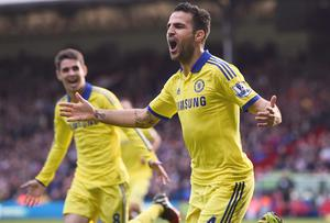 Chelsea goalscorers Cesc Fabregas and Oscar celebrate after Fabregas puts the Blues two goals ahead against Crystal Palace in their Premier League clash at Selhurst Park. Photo: REUTERS/Dylan Martinez