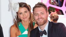 Vogue Williams and Brian McFadden attend the Lavazza marquee on Crown Oaks Day at Flemington Racecourse on November 8, 2012 in Melbourne, Australia.  (Photo by Scott Barbour/Getty Images)