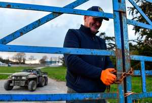 LOCKDOWN: Groundsman TJ Leahy locks the gates following racing at Clonmel Racecourse. Photo: Seb Daly/Sportsfile