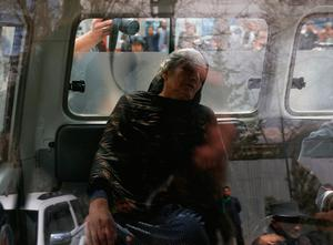 An injured woman sits inside an ambulance during the gun fire outside a military hospital in Kabul, Afghanistan March 8, 2017.  REUTERS/Omar Sobhani