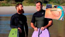 Best friends Shane De Roiste (left) and Dale Carr were surfing 200m from shore when a great white latched on to Dale's thigh and buttocks