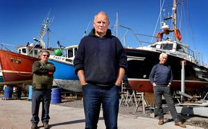 Boatmen Fionán Murphy (centre), Pat Joe Murphy (left) and Seanie Murphy have their vessels in dry dock in Valentia, Co Kerry as Covid-19 has shut down their trips to Skellig Michael. Photo: Steve Humphreys