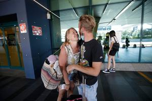 Reunited: Andrea Monti hugs his girlfriend Katherina Scherf who just arrived from Duesseldorf, Germany at Rome's Fiumicino airport. Photo: Reuters