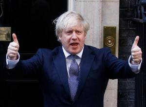 Britain's Prime Minister Boris Johnson reacts outside 10 Downing Street during the Clap for our Carers campaign in support of the NHS, following the outbreak of the coronavirus disease (COVID-19), London, Britain, May 14, 2020. REUTERS/Henry Nicholls