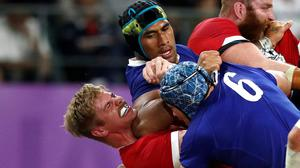 Sebastien Vahaamahina elbows Wales' Aaron Wainwright in the incident which saw the France player sent off. Photo: Edgar Su/Reuters