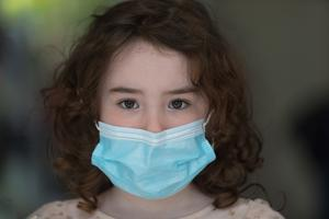 5-year-old Lana-Rose Breslin with her Covid-19 facemask