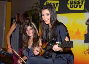 Kylie Jenner and Kim Kardashian play Guitar Hero World Tour at Best Buy First Look - Guitar Hero World Tour in Los Angeles, CA on October 18, 2008.  (Photo by Polk Imaging/FilmMagic)